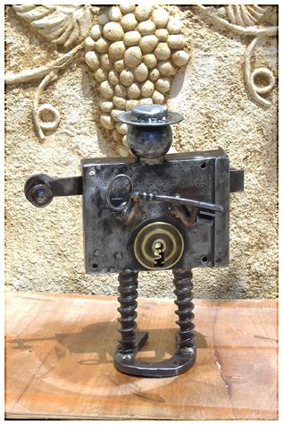 Le serrurier - Sculpture de métal